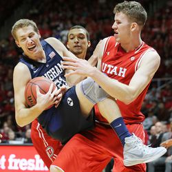 Brigham Young Cougars forward Kyle Davis (21) gets caught up with Utah Utes forward Jakob Poeltl (42) as Utah and BYU play in the Huntsman Center in Salt Lake City Wednesday, Dec. 2, 2015.