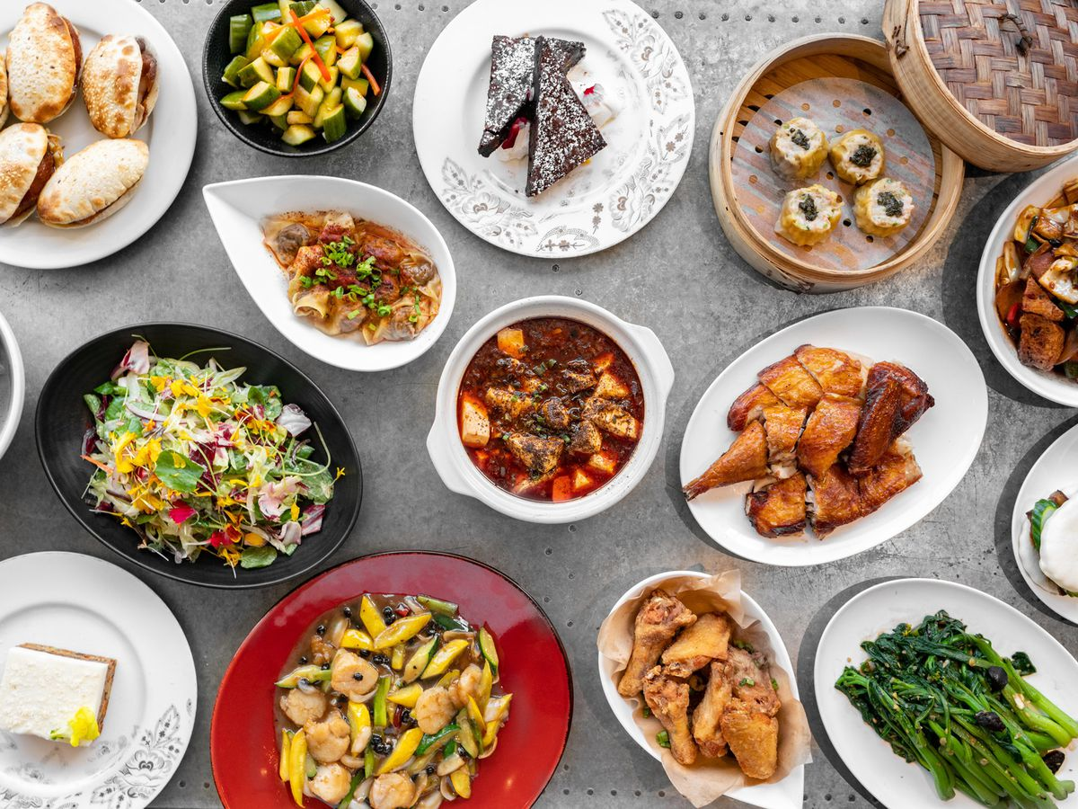 A table of plates with entrees and dumplings from China Live.