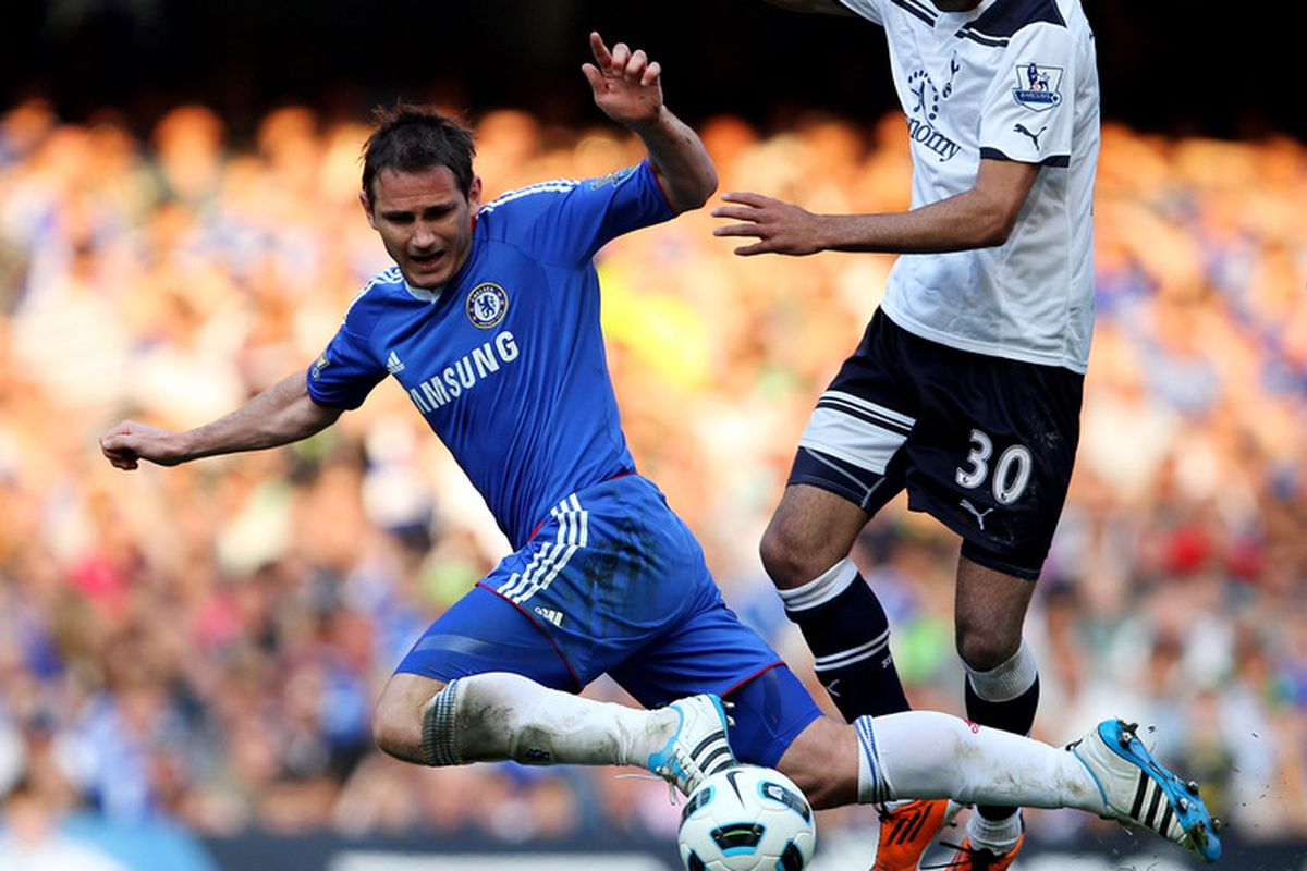 Frank Lampard of Chelsea is brought down by Sandro of Spurs during the Barclays Premier League match between Chelsea and Tottenham Hotspur