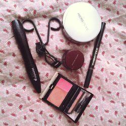 My daily makeup routine: <b>Amore Pacific</b> Cushion Compact, <b>Kevyn Aucoin</b> Sensual Skin Enhance, Kevyn Aucoin's Sensual Glow, <b>Surratt Beauty</b> eyelash curler, and a <b>Dolce and Gabbana</b> eyebrow pencil. Cushion compacts are the latest Kore