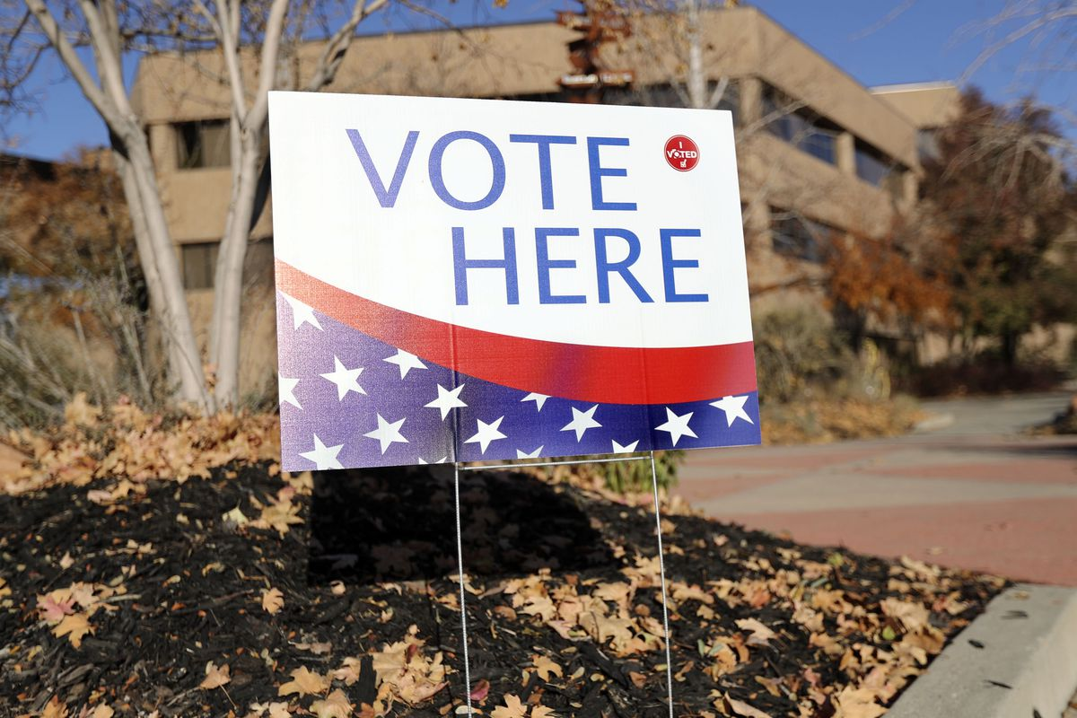 """A """"Vote Here"""" sign is pictured on Election Day at the Salt Lake County Government Center in Salt Lake City on Tuesday, Nov. 5, 2019."""