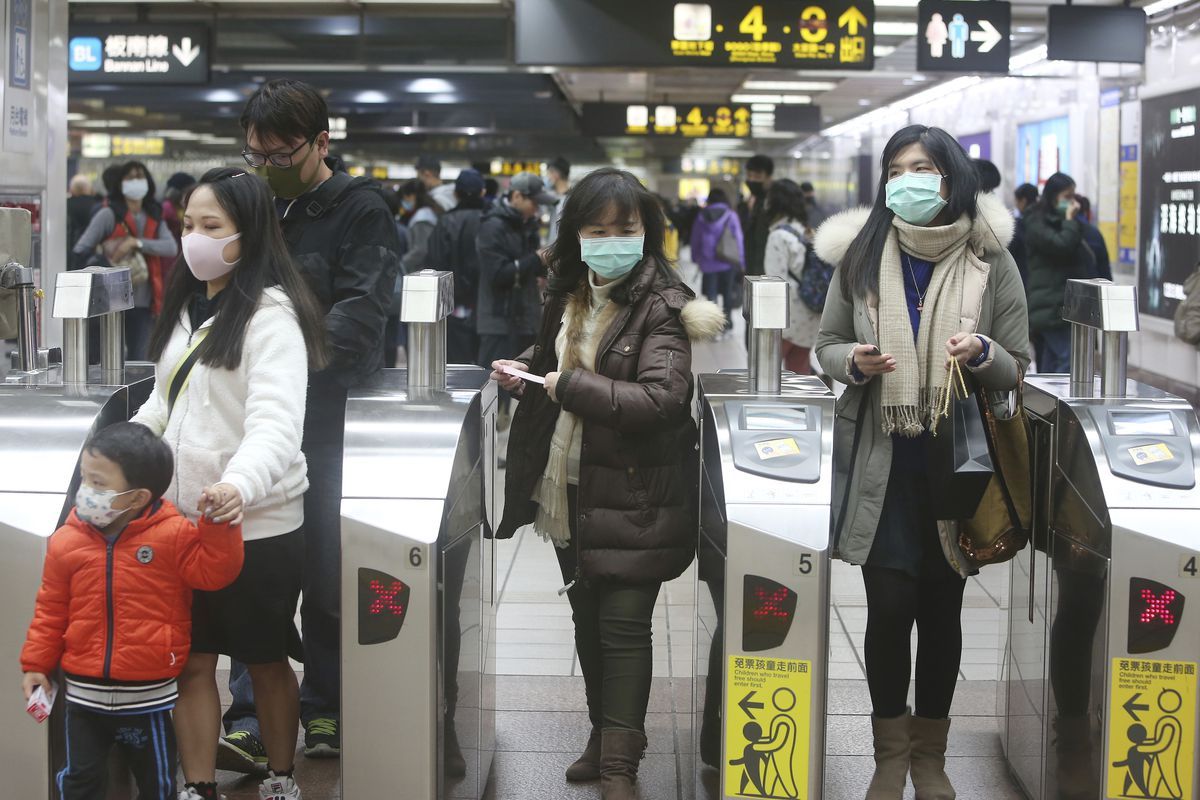People wear masks at a metro station in Taipei, Taiwan, Tuesday, Jan. 28, 2020.