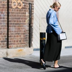 Those black and white Balenciaga bags were pretty popular on the streets of Sydney. Here it is again paired with a blue blouse and Gucci slides.