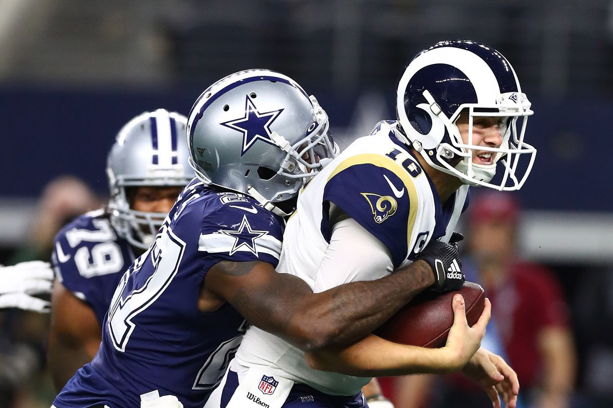 Los Angeles Rams quarterback Jared Goff is sacked by Dallas Cowboys cornerback Jourdan Lewis in the fourth quarter at AT&T Stadium.