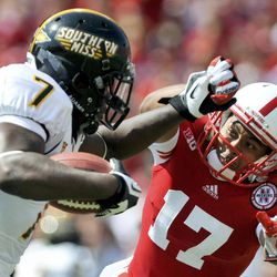 Sourthern Miss's Desmond Johnson (7) fights off Nebraska's Ciante Evans (17) during their NCAA college football game, Saturday, Sept. 1, 2012, in Lincoln, Neb.