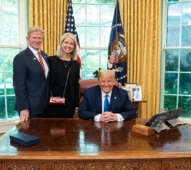 State Rep. Chris Miller, left, and U.S. Rep. Mary Miller, center, with then President Donald Trump.