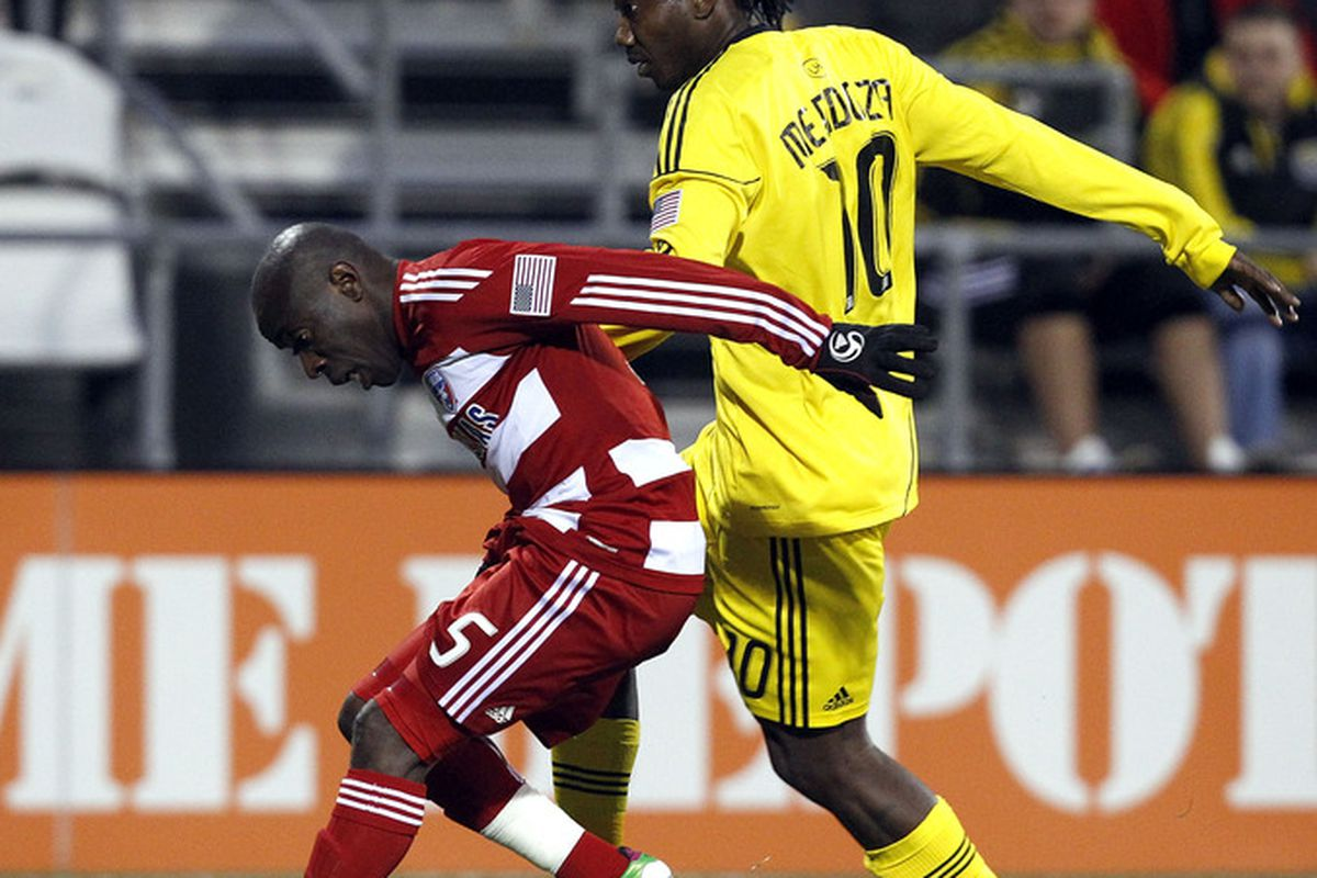 COLUMBUS, OH - APRIL 01:  Andres Mendoza #10 of the Columbus Crew fights for the ball with Jair Benitez #5 of FC Dallas at Crew Stadium on April 1, 2011 in Columbus, Ohio.  (Photo by Matt Sullivan/Getty Images)