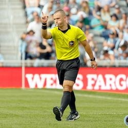 August 4, 2019 - Saint Paul, Minnesota, United States - Referee Chris Penso signals a penalty kick for Minnesota United after reviewing the play with VAR for a handball in the box by Portland Timbers defender Larrys Mabiala (33) during the match at Allianz Field.