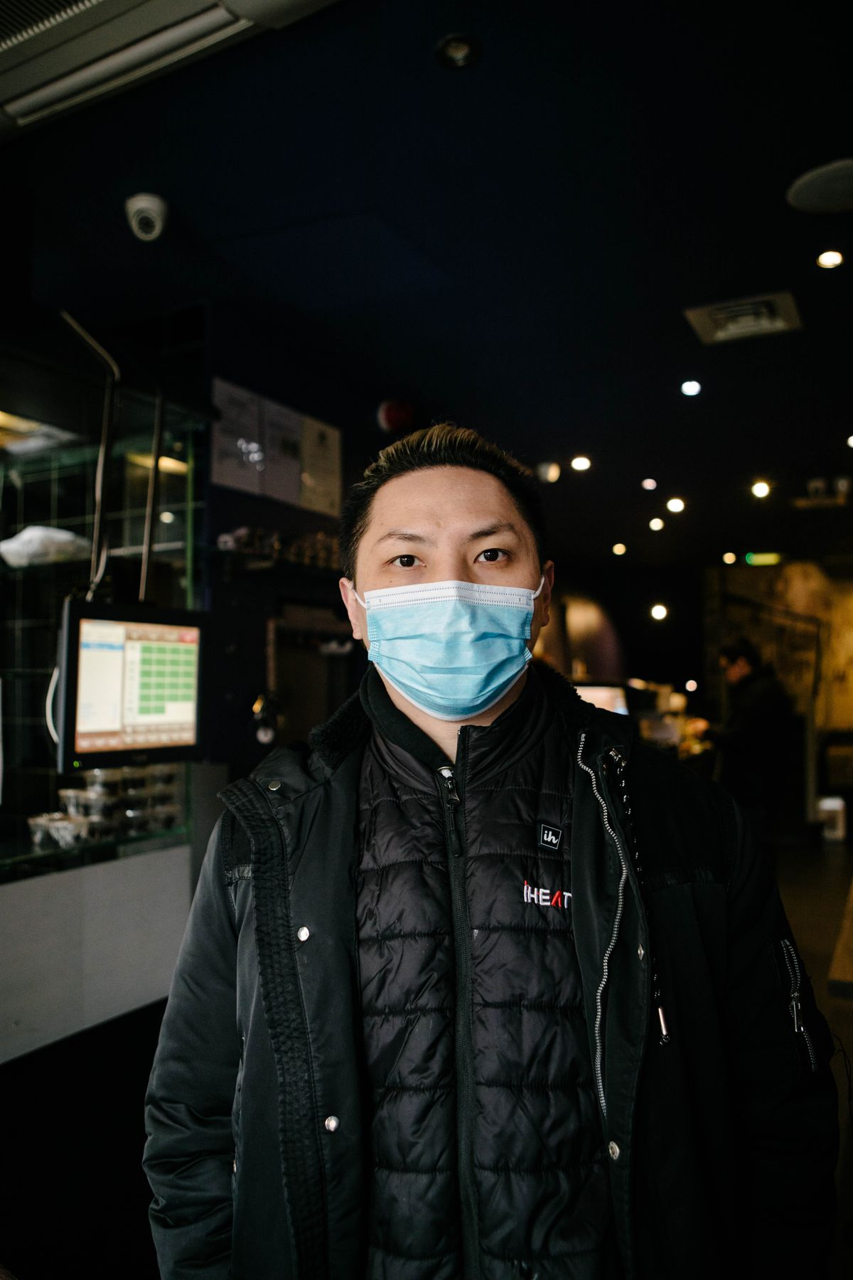A portrait of a chef in a mask at Old Town 97 in Chinatown