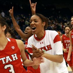 Utah's Malia Nawahine, left, celebrates Utah's win over BYU in a women's basketball game at the Marriott Center in Provo on Saturday, Dec. 14, 2013. Utah won in double overtime 82-74.