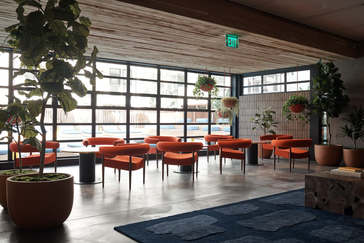 Communal sitting area with orange chairs