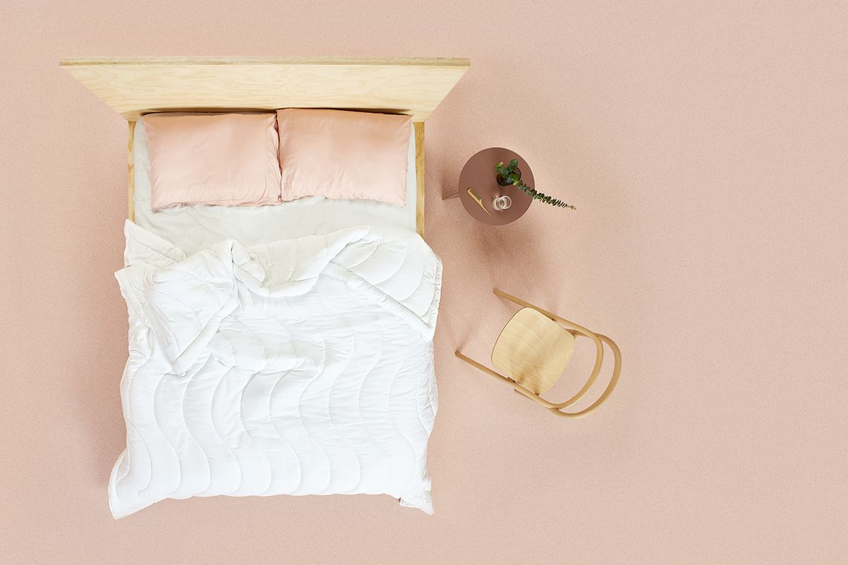 Overhead shot of bed with white comforter