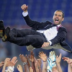FILE - In this Wednesday May 27, 2009 file photo Barcelona coach Pep Guardiola is thrown in the air in celebration, at the end of the UEFA Champions League final soccer match between Manchester United and Barcelona in Rome. Pep Guardiola will not continue as Barcelona's coach after this season, according to Spanish news reports. Guardiola, whose contract expires at the end of the season, is scheduled to announce his decision on Friday in a news conference at 1330 local time (1130 GMT) with club president Sandro Rosell and sports director Andoni Zubizarreta.