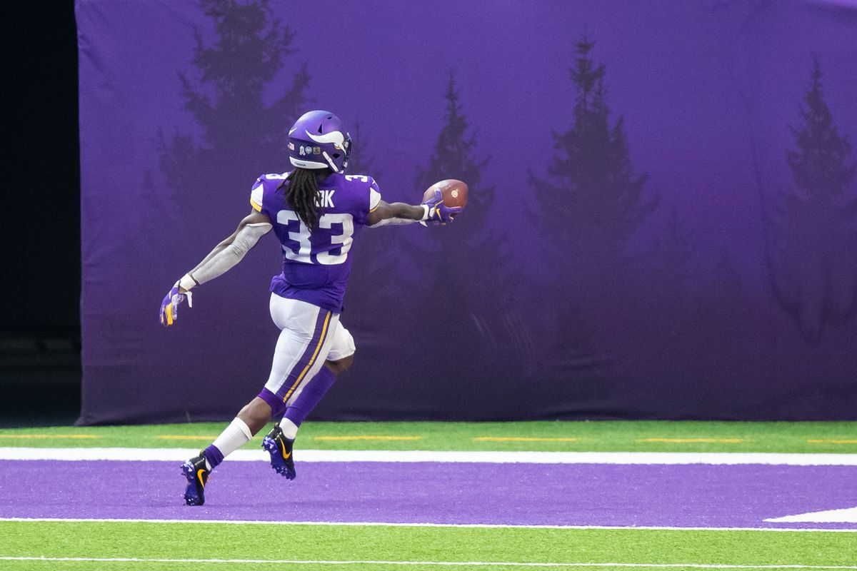 Minnesota Vikings running back Dalvin Cook (33) celebrates his touchdown in the fourth quarter against the Detroit Lions at U.S. Bank Stadium.