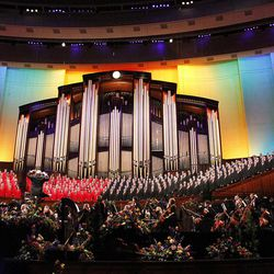 Backdrop of LDS Conference Center stage is lighted in rainbow spectrum as Mormon Tabernacle Choir and Orchstra at Temple Square, conducted by music director Mack Wilberg, performs the song ?Over the Rainbow? during July 19, 2012 dress rehearsal for Pioneer Day concert.