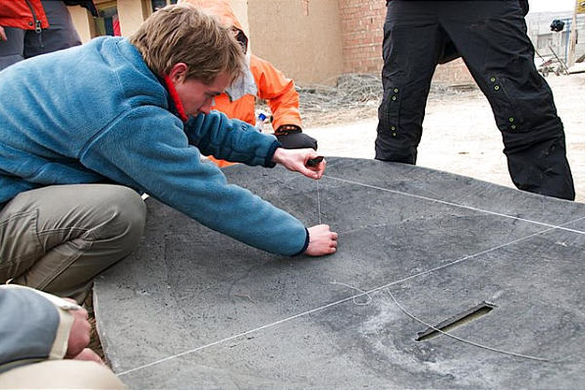 Scot Frank, a current student at MIT and West High graduate, helps to build a new solar cooker in a rural area of Tibet.