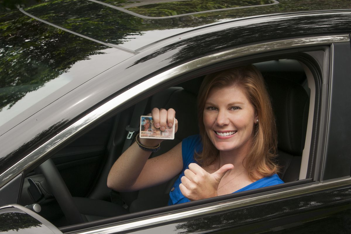 This happy driver could save 5 percent or less on car insurance.