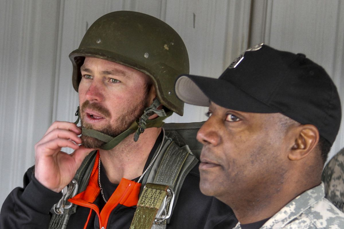 First Sgt. Jonas Woodruff, noncommissioned officer in charge of the 82nd Airborne Division's Advanced Airborne School, and Mike Dunn, a pitcher for Major League Baseball's Miami Marlins, stand inside the school's 34-foot tower at Fort Bragg, N.C.
