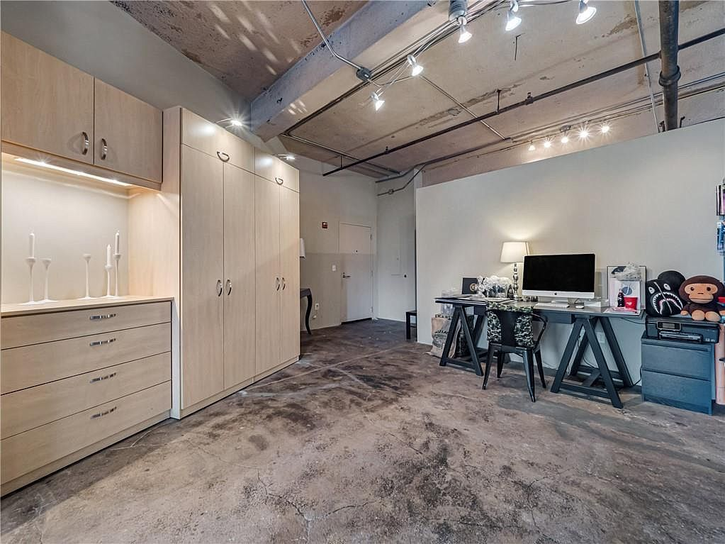 A large white and concrete loft space.