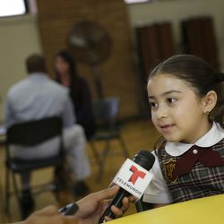Third-grader Emely Rodriguez is interviewed during a news conference at Our Lady Queen of Angels Catholic school in New York, Thursday, Aug. 20, 2015. Emely will be among 24 students to meet with Pope Francis in a private audience during his visit to New York in late September. (AP Photo/Seth Wenig)