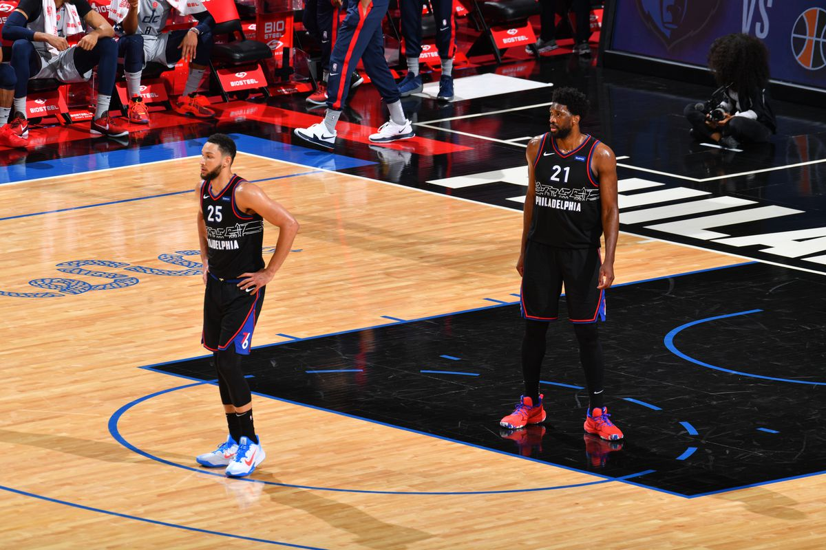 Ben Simmons of the Philadelphia 76ers and Joel Embiid of the Philadelphia 76ers looks on during a game against the Washington Wizards during Round One Game Two of the Eastern Conference Playoffs on May 26, 2021 at Wells Fargo Center in Philadelphia, Pennsylvania.