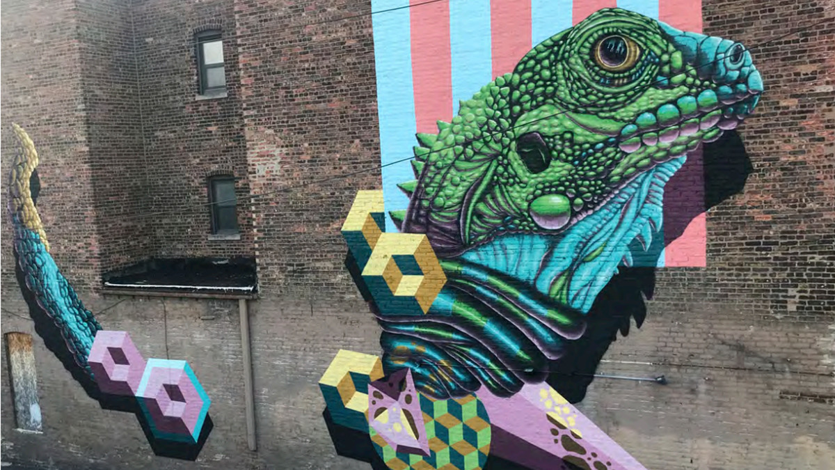 """This giant mural of an iguana was painted on a restaurant at 2914 N. Clark St. in Chicago in 2018 by Canadian artist Jerry Rugg, who goes by """"birdO."""""""
