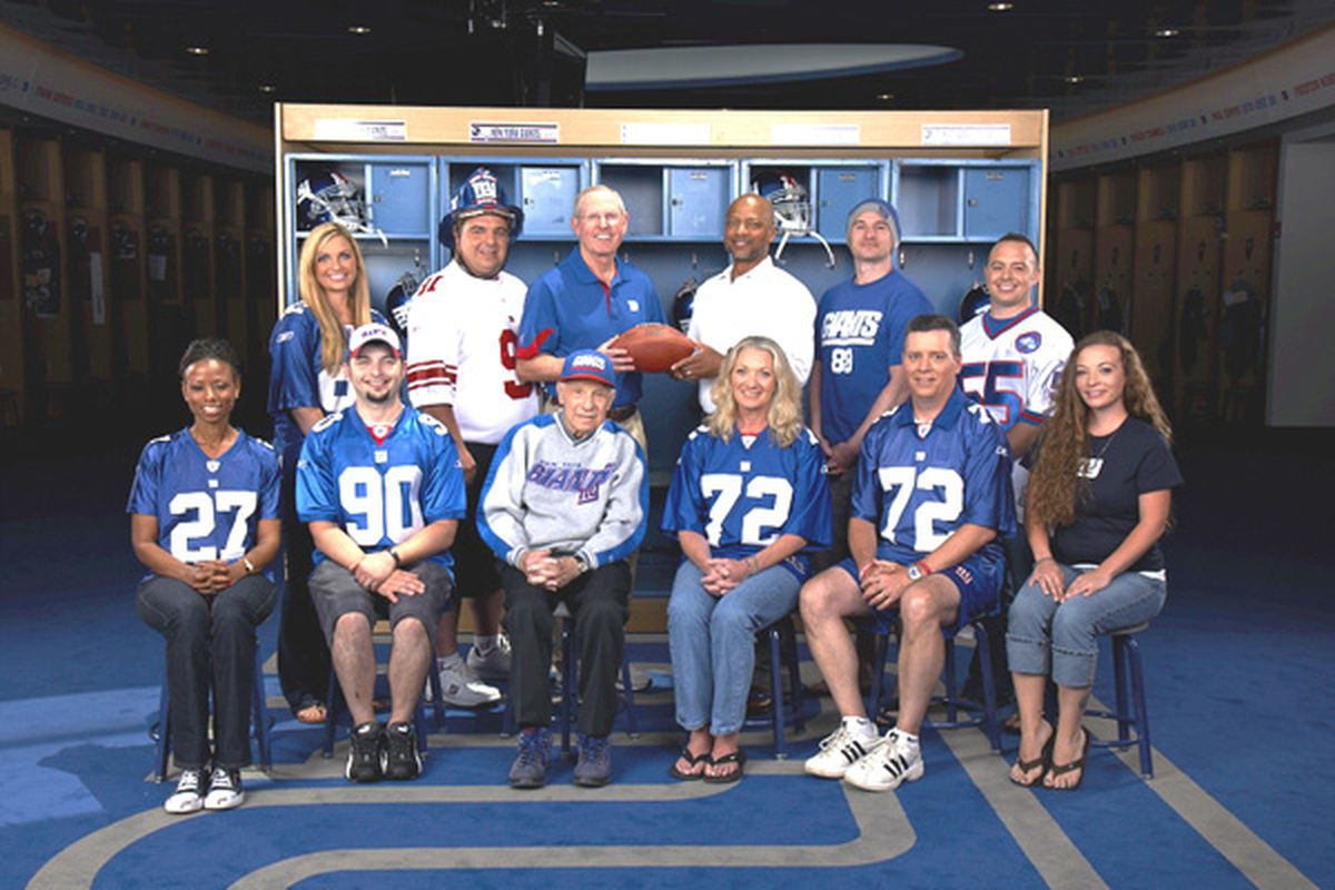 Winners of the Ultimate Giants Fan Contest, who will have their pictures on tickets to various games for the 2011 season, are shown with New York Giants coach Tom Coughlin and general manager Jerry Reese.