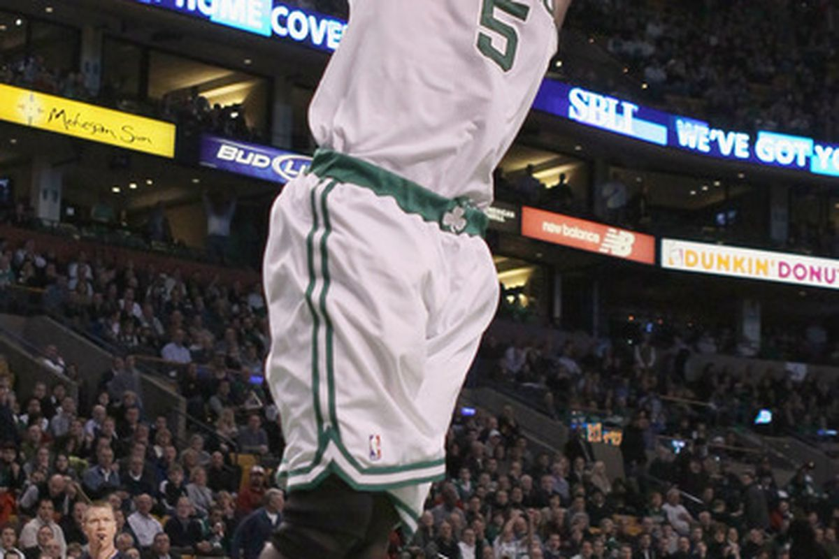Kevin Garnett finishes off a fast break with a dunk against the Denver Nuggets.