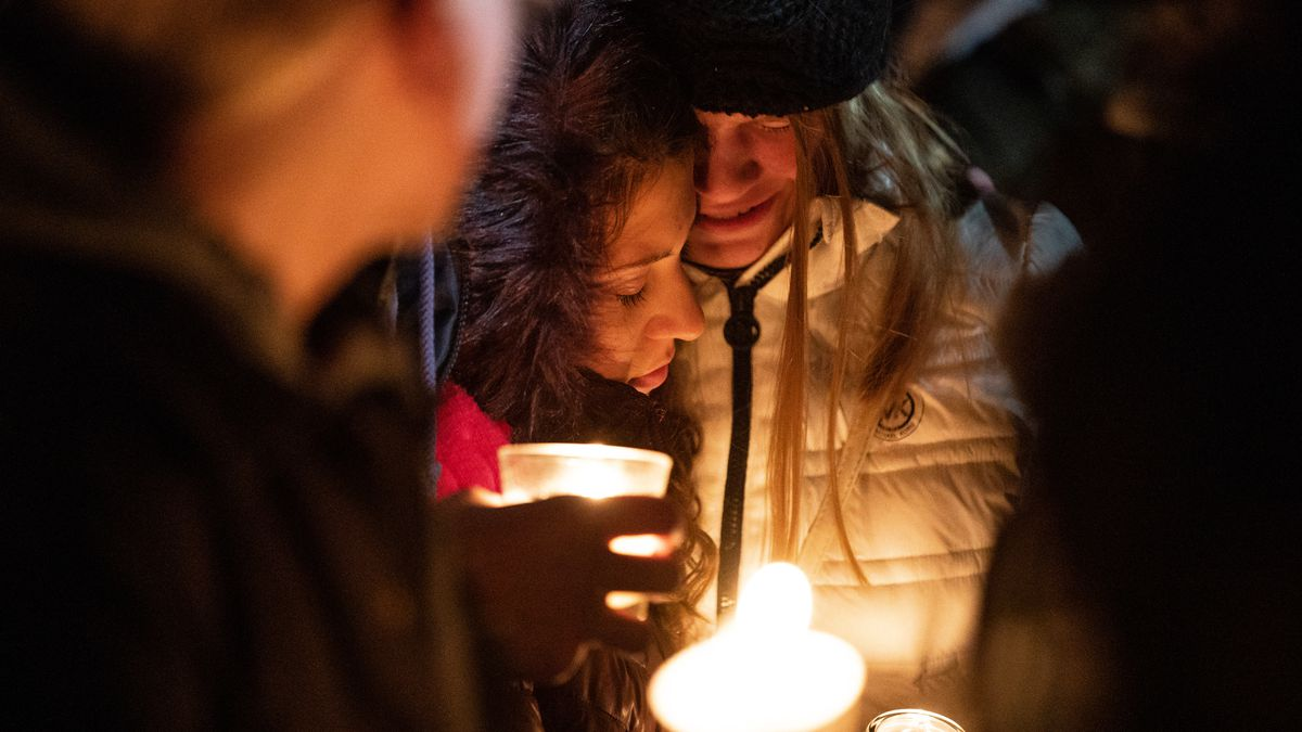 Jade Trapp, 16, and Audrey Curtiss, 15, both students at Grantsville High School, embrace during a candlelight vigil for the Haynie family at Grantsville City Park on Monday, Jan. 20, 2020. Police say four members of the Haynie family were killed and one injured after being shot by a teenage family member on Jan. 17.