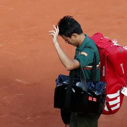 Japan's Kei Nishikori leaves the court after losing to Britain's Andy Murray during their quarterfinal match of the French Open tennis tournament at the Roland Garros stadium, Wednesday, June 7, 2017 in Paris. Murray won 2-6, 6-1, 7-6, 6-1.