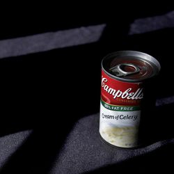 FILE-In this Wednesday, Aug. 31, 2011, file photo, light shines on a can of Campbell's soup in Moreland Hills, Ohio. Campbell Soup Co. announced Tuesday, Sept. 4, 2012, that net income rose 27 percent in its fiscal fourth quarter. The results beat analysts' expectations and the food maker gave fiscal 2013 revenue guidance above Wall Street's view.