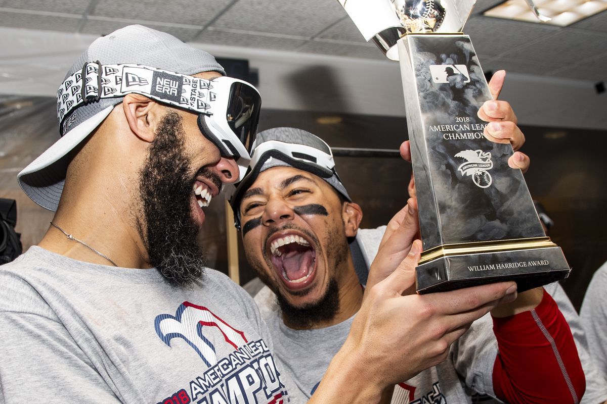 David Price and Mookie Betts of the Boston Red Sox celebrate with the American League Championship Series trophy in the clubhouse after clinching the American League Championship Series in game five against the Houston Astros on October 18, 2018 at Minute Maid Park in Houston, Texas.