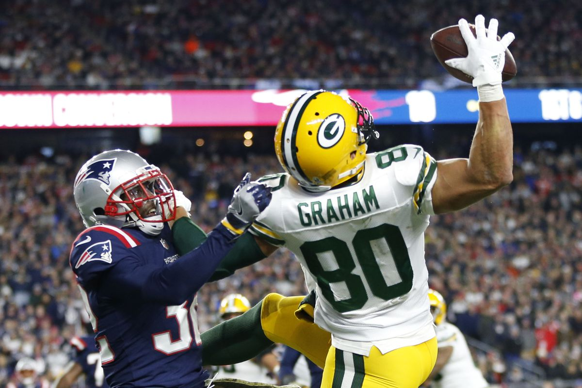 Green Bay Packers tight end Jimmy Graham (80) is defended by New England Patriots free safety Devin McCourty during the second quarter at Gillette Stadium.