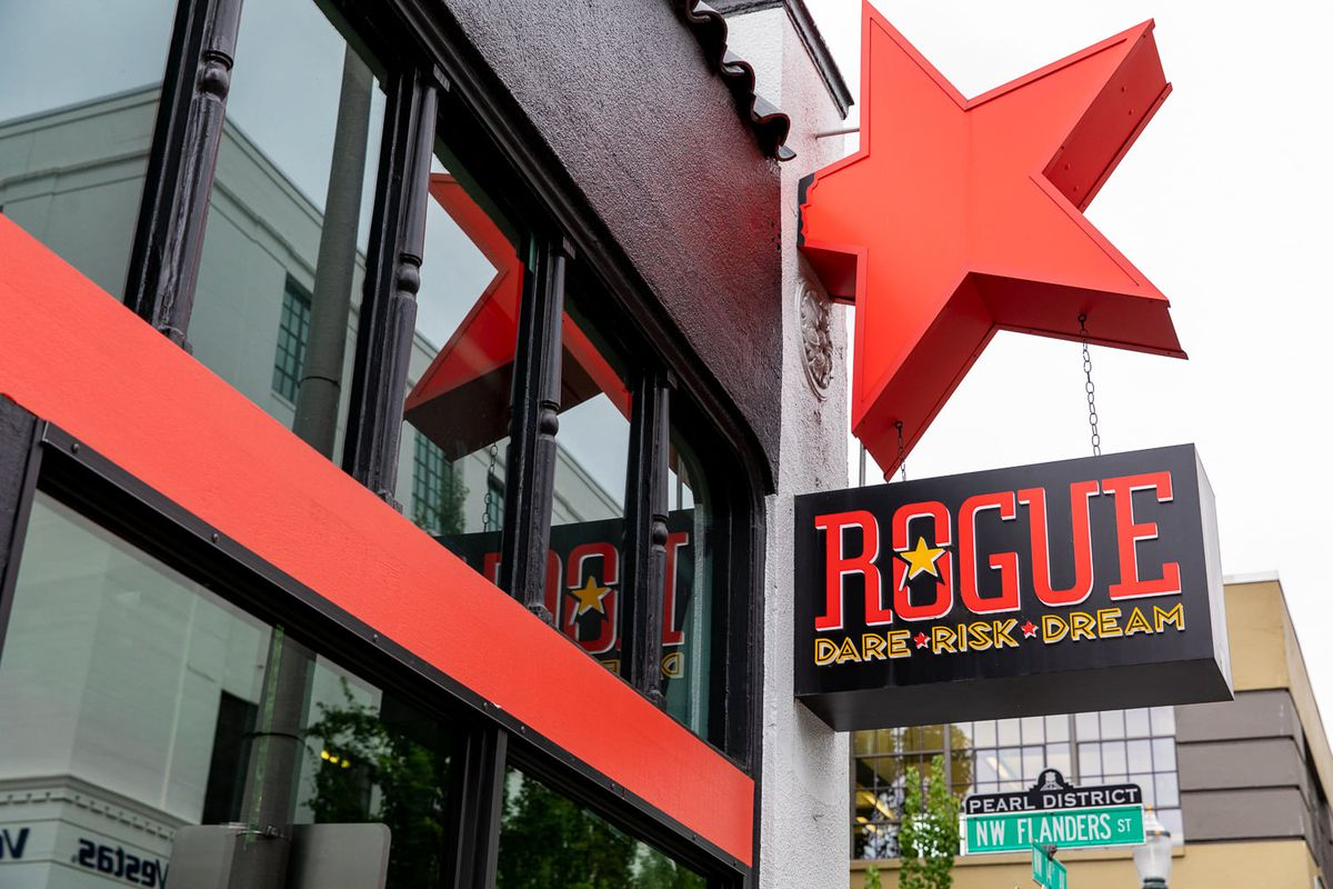 The red star of Rogue's logo juts out from the wall of its Pearl District pub, which closes Sept. 20, 2020