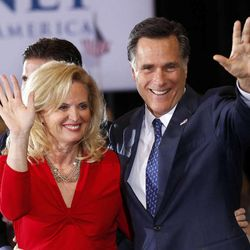 Republican presidential candidate, former Massachusetts Gov. Mitt Romney, waves to supporters with his wife Ann at his election watch party after winning the Michigan primary in Novi, Mich., Tuesday, Feb. 28, 2012.\r\n