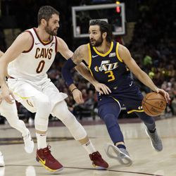 Utah Jazz's Ricky Rubio (3), from Spain, drives past Cleveland Cavaliers' Kevin Love (0) in the first half of an NBA basketball game, Saturday, Dec. 16, 2017, in Cleveland. (AP Photo/Tony Dejak)