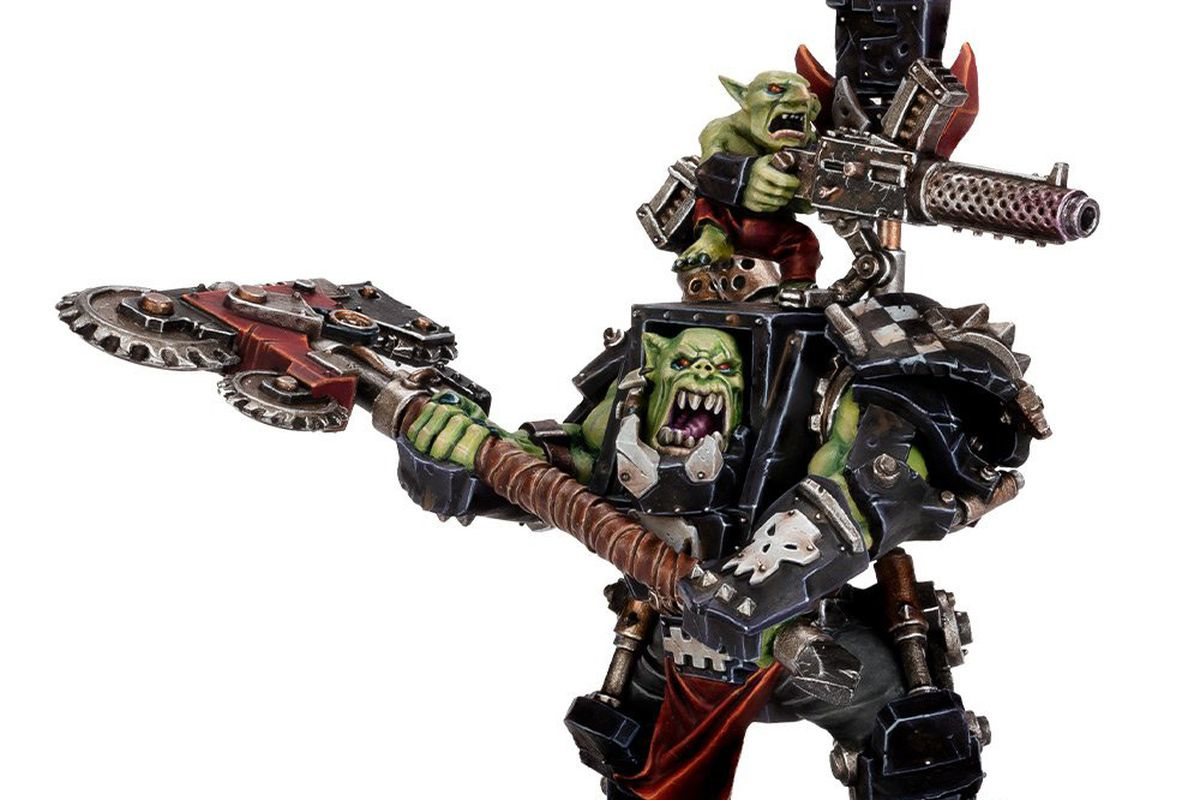 An Ork Warboss in armor. Note the wee li'l rot up on his shoulders with a stubber. He's so CUTE!
