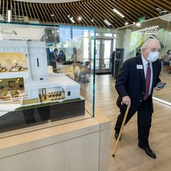 Roc Arnett, a local communications specialist, walks past a model of The Church of Jesus Christ of Latter-day Saints' Mesa Arizona Temple inside of the temple's visitors' center following a media tour the newly renovated temple in Mesa, Ariz., on Monday, Oct. 11, 2021.