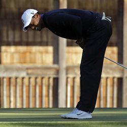 Tiger Woods reacts after missing a putt on the 11th hole for a bogie during the second round of the Masters golf tournament Friday, April 6, 2012, in Augusta, Ga.