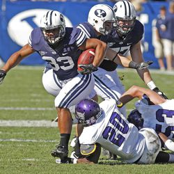 Brigham Young Cougars running back Paul Lasike (33) runs as Brigham Young University defeats Weber State University in football 45-6 Saturday, Sept. 8, 2012, in Provo, Utah.