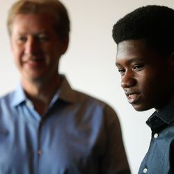 Getro Joseph, a young cellist from Haiti, stands with Utah Symphony cellist John Eckstein at Abravanel Hall in Salt Lake City on Saturday, Dec. 7, 2019.