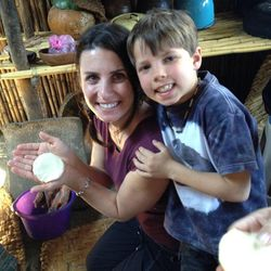 Kat Dayton and her oldest son, Zeke, learn to make tortillas in the Mayan Women's Cooperative in San Antonio, Guatemala.
