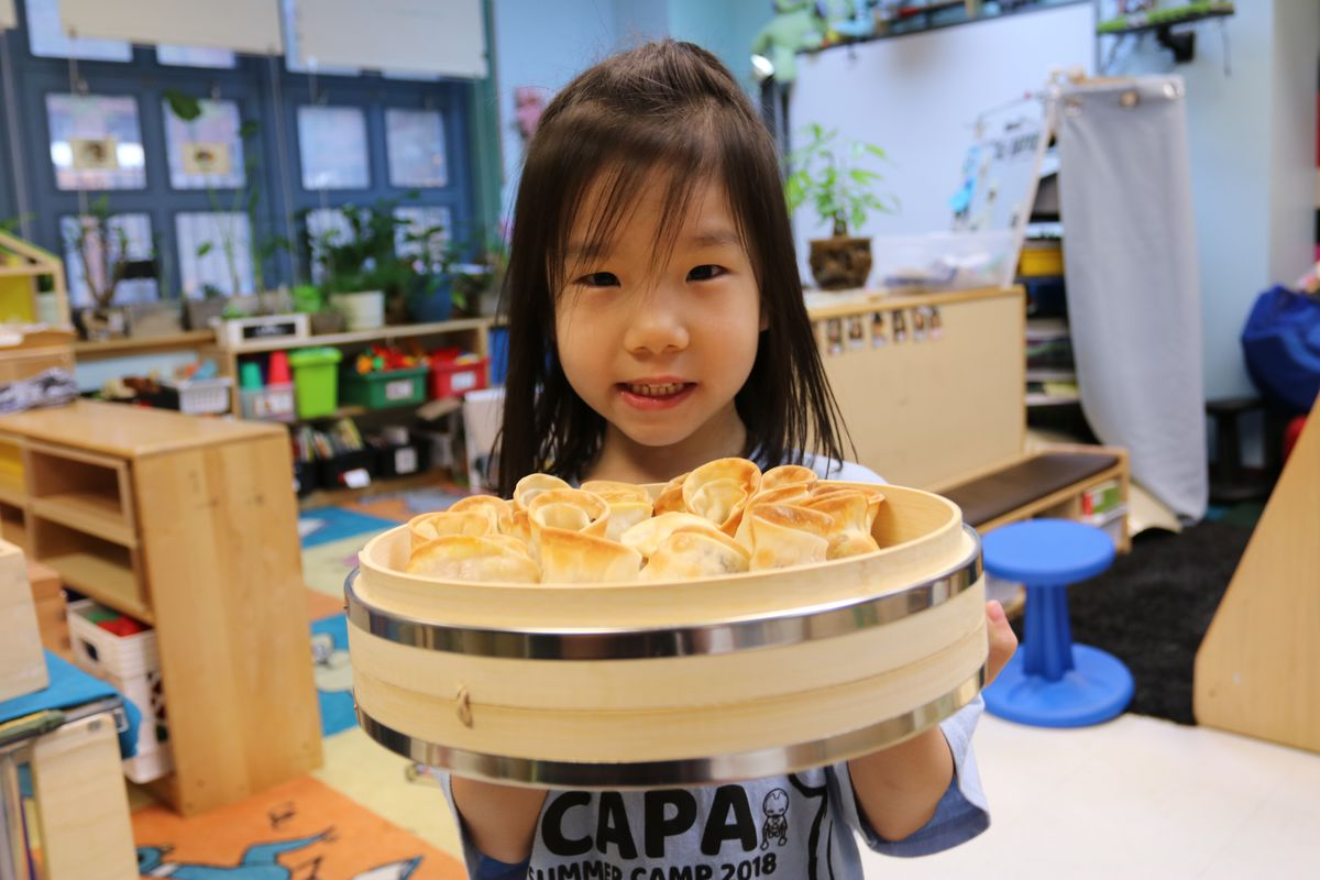 One of Andy Yung's campers shows off the dumplings they made.