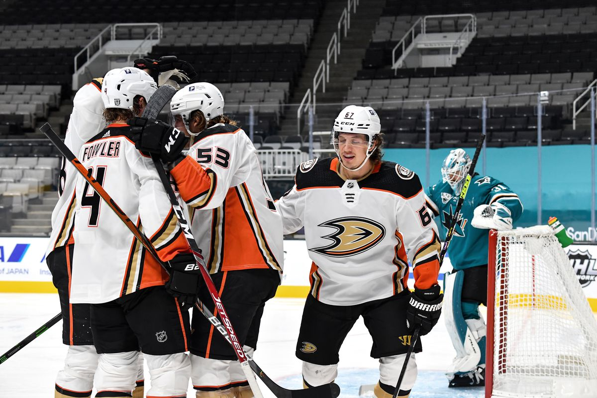 Max Comtois #53 and Cam Fowler #4 of the Anaheim Ducks celebrate scoring a goal against the San Jose Sharks at SAP Center on February 15, 2021 in San Jose, California.