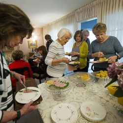 Linda Kruse, Former Utah First Lady Norma Matheson, Bonnie Farr and Diane Hale pick food items as they meet with a group of friends for their monthly book club on at the home of Carol McFarland on Thursday, April 20, 2017.