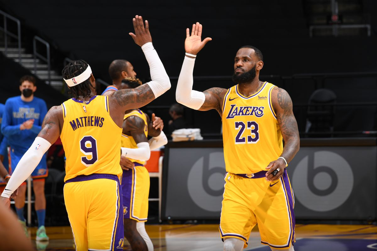 LeBron James hi-fives Wesley Matthews of the Los Angeles Lakers during the game against the Oklahoma City Thunder on February 10, 2021 at STAPLES Center in Los Angeles, California.