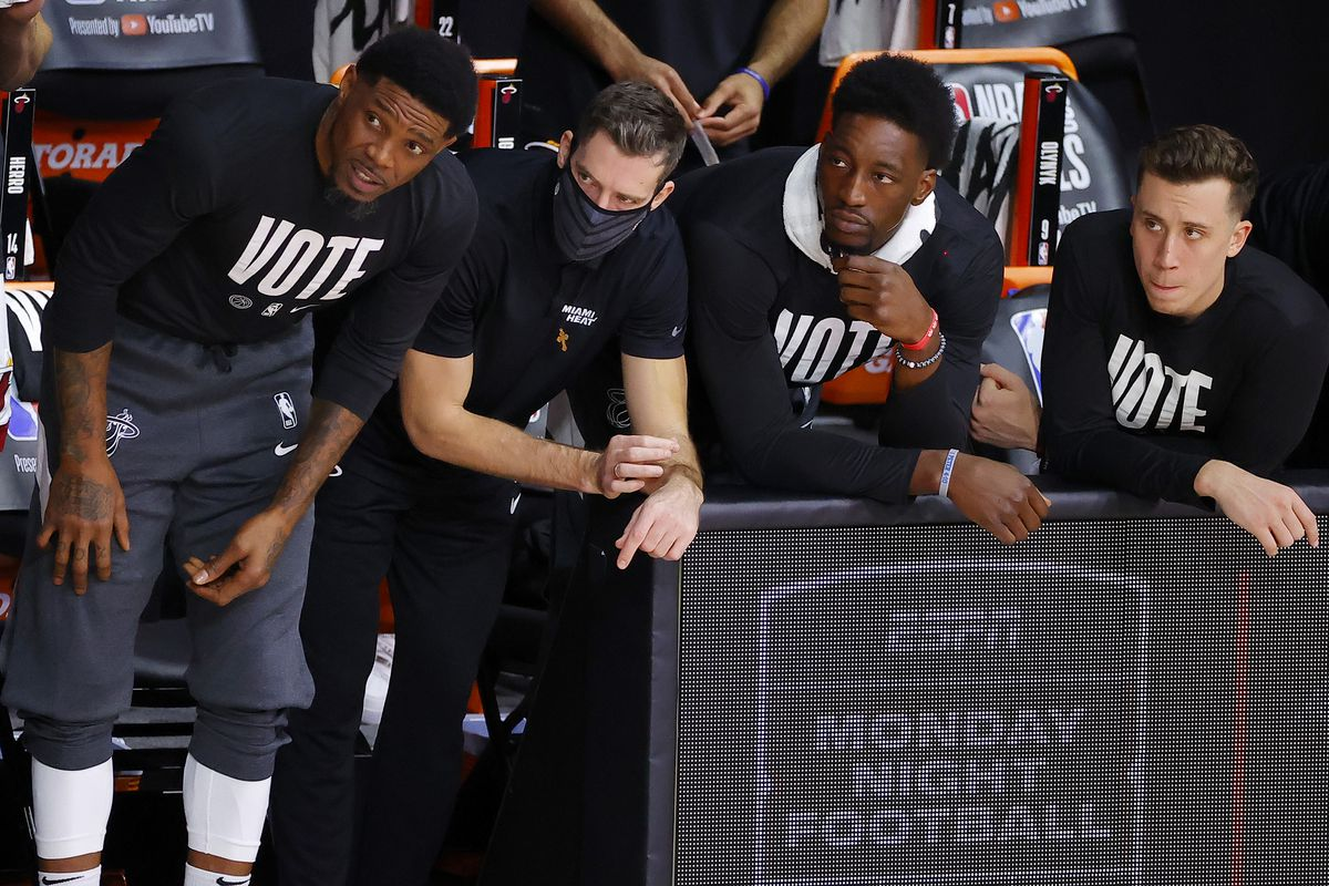 Goran Dragic and Bam Adebayo of the Miami Heat look on from the bench during Game Two of the 2020 NBA Finals against the Los Angeles Lakers at AdventHealth Arena at ESPN Wide World Of Sports Complex on October 02, 2020 in Lake Buena Vista, Florida.