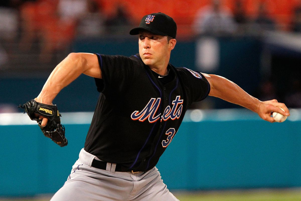 MIAMI GARDENS, FL - SEPTEMBER 05:  Chris Capuano #38 of the New York Mets pitches during a game against the Florida Marlins at Sun Life Stadium on September 5, 2011 in Miami Gardens, Florida.  (Photo by Mike Ehrmann/Getty Images)