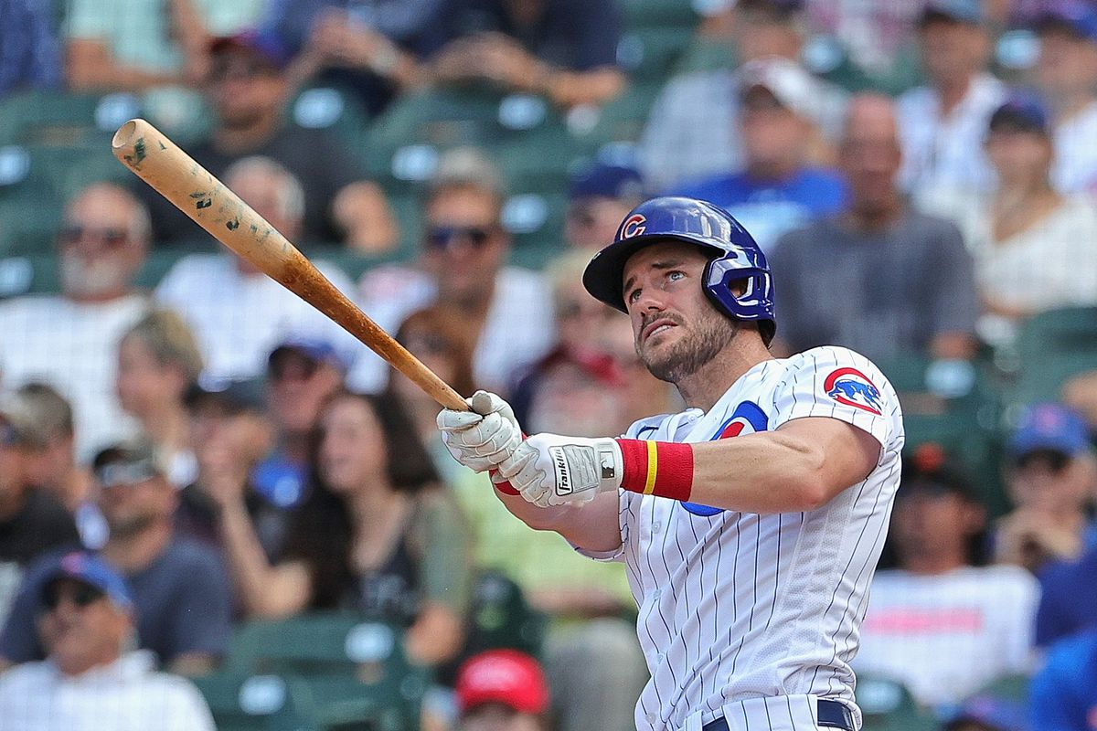 The Cubs' Patrick Wisdom hits a three-run homer in Game 1 of Wednesday's doubleheader against the Rockies.