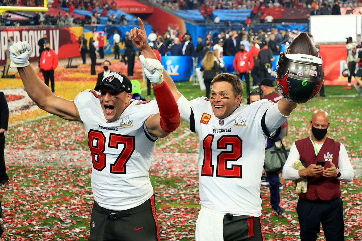 Rob Gronkowski and Tom Brady of the Tampa Bay Buccaneers celebrate after defeating the Kansas City Chiefs in Super Bowl LV at Raymond James Stadium on February 07, 2021 in Tampa, Florida.
